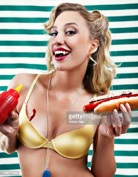 Vampire pin up with bloody hot dogs