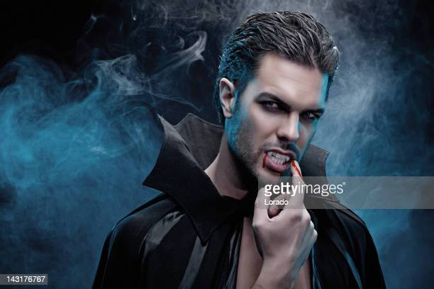 Vampire tasting blood from his finger