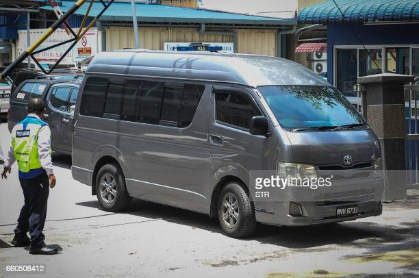 A van believed to be carrying the body of Kim JongNam the halfbrother of North Korea's leader Kim JongUn leaves the forensics wing of the Hospital...