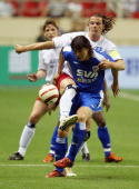 Van Buyten of Germany's Hamburg HSV fights for the ball with a player of China's Shanghai Shenhua during the friendly match between Germany`s Hamburg...