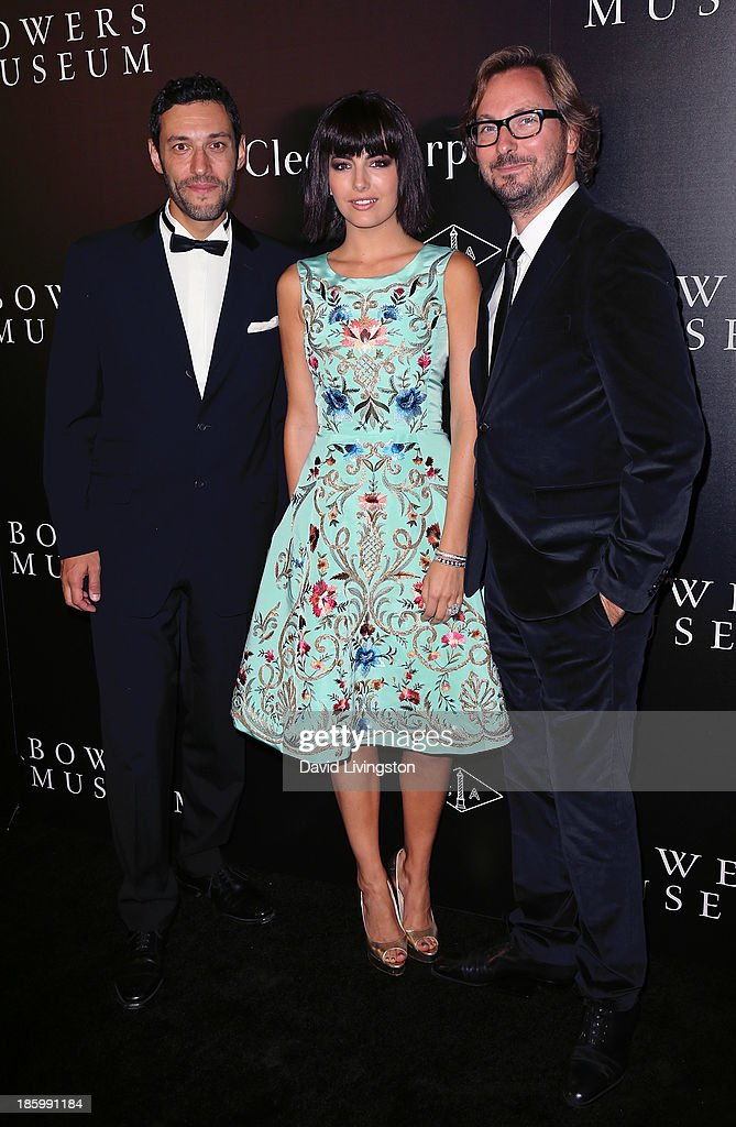 Van Cleef & Arpels CEO of the Americas Alain Bernard, actress <a gi-track='captionPersonalityLinkClicked' href=/galleries/search?phrase=Camilla+Belle&family=editorial&specificpeople=210585 ng-click='$event.stopPropagation()'>Camilla Belle</a> and Nicolas Bos, Global CEO and Creative Director at Van Cleef & Arpels attend 'A Quest for Beauty: The Art of Van Cleef & Arpels' new exhibit opening night reception at The Bowers Museum on October 26, 2013 in Santa Ana, California.