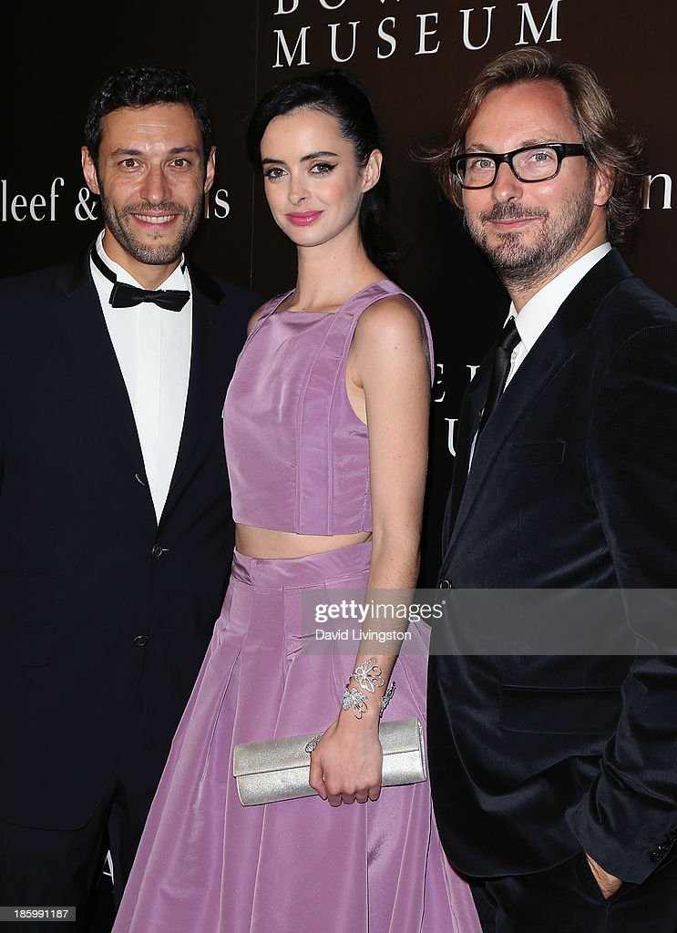 Van Cleef & Arpels CEO of the Americas Alain Bernard, actress <a gi-track='captionPersonalityLinkClicked' href=/galleries/search?phrase=Krysten+Ritter&family=editorial&specificpeople=655673 ng-click='$event.stopPropagation()'>Krysten Ritter</a> and Nicolas Bos, Global CEO and Creative Director at Van Cleef & Arpels attend 'A Quest for Beauty: The Art of Van Cleef & Arpels' new exhibit opening night reception at The Bowers Museum on October 26, 2013 in Santa Ana, California.