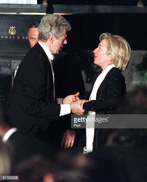 Van Cliburn And US First Lady Hillary Rodham Clinton Hold Hands After His Performance At The State Dinner For Prime Minister Obuchi Of Japan May 3...