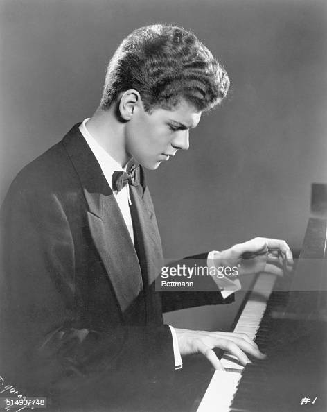 Van Cliburn famous pianist and first American to win Moscow's Tchaikovsky Prize Depicted in his teens or early twenties waistup playing the piano...