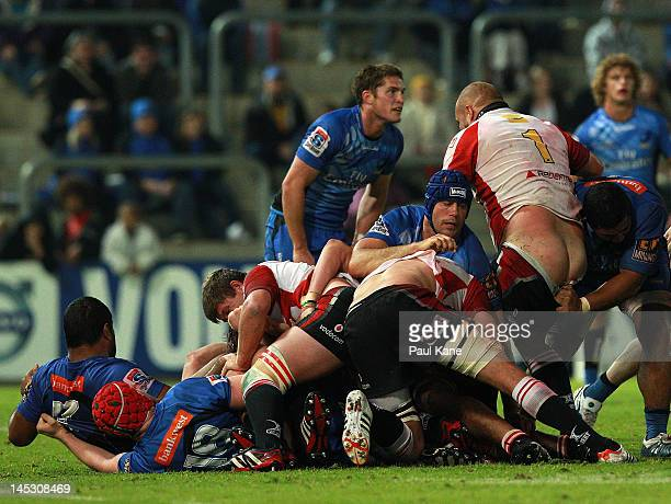 Van Der Linde of the Lions gets his shorts pulled down during the round 14 Super Rugby match between the Western Force and the Lions at NIB Stadium...
