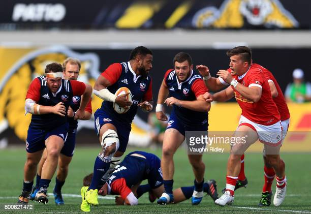 Van Der Merwe of Canada chases Andrew Durutalo of the USA during the second half of a Rugby World Cup 2019 Qualifier match at Tim Hortons Field on...