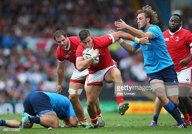 Van Der Merwe of Canada holds off a challenge from Josh Furno of Italy during the 2015 Rugby World Cup Pool D match between Italy and Canada at...
