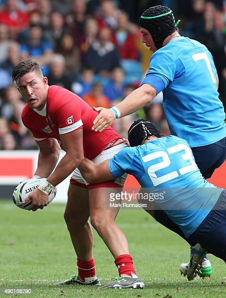 Van Der Merwe of Canada is tackled by Francesco Minto and Michele Campagnaro of Italy during the 2015 Rugby World Cup Pool D match between Italy and...