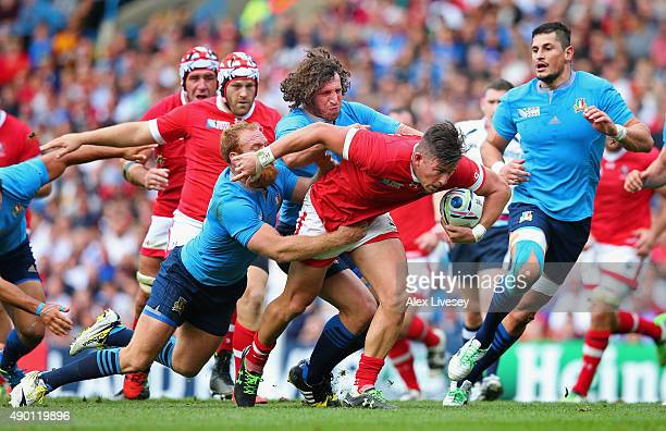 Van Der Merwe of Canada is tackled by Gonzalo Garcia and Mauro Bergamasco of Italy during the 2015 Rugby World Cup Pool D match between Italy and...