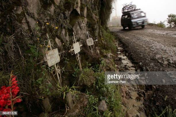 A van descends past a series of crosses marking the site of fatal accidents on the road connecting the city of La Paz to the Coroico in the North...