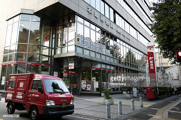 A van drives past a Japan Post Co post office in Tokyo Japan on Monday Oct 26 2015 Japan Post Holdings and its banking unit rallied above their...