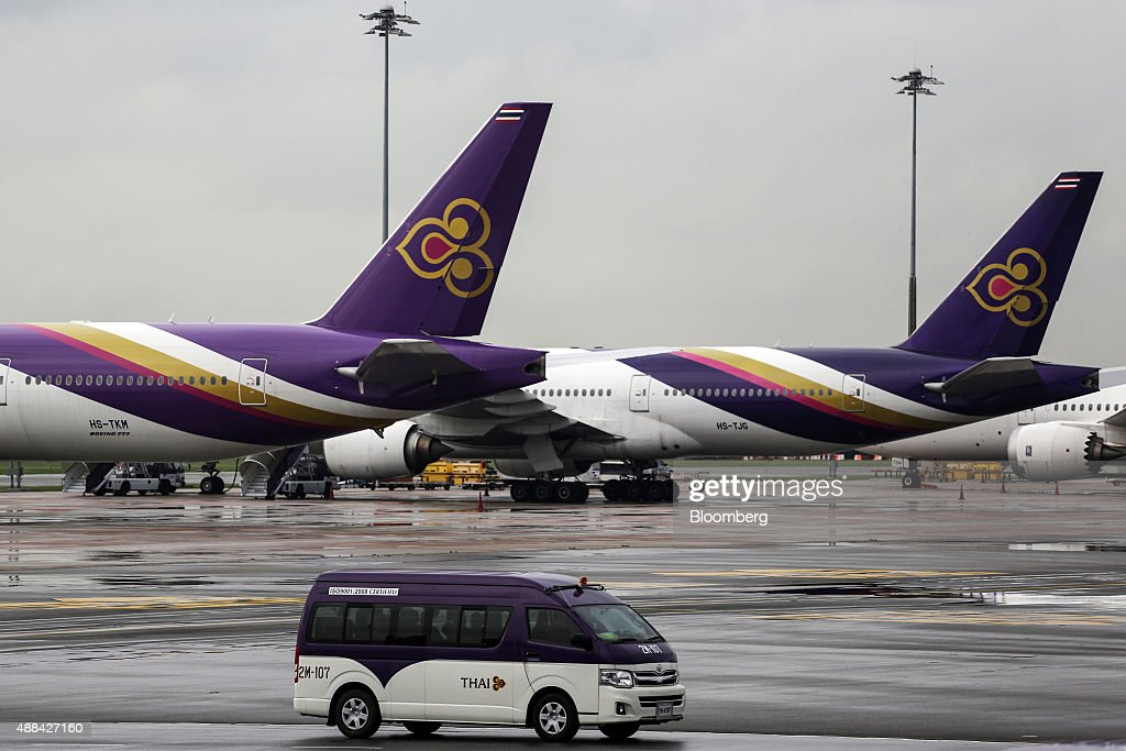 A van drives past aircraft operated by Thai Airways International Pcl on the tarmac at Suvarnabhumi Airport in Bangkok Thailand on Wednesday Sept 16...