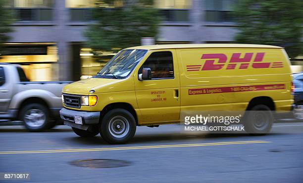 A DHL van drives past in Washington DC on November 13 2008 The Deutsche Post said on November 10 2008 it would cut 9500 posts as part of a program to...