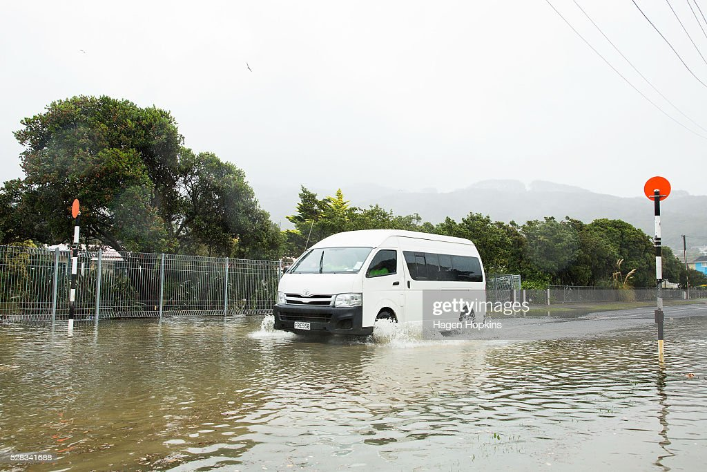 A van drives through water on Awarua Street after heavy rain caused flooding on May 5, 2016 in Porirua, New Zealand. Severe rain warnings have been issued for the bottom of the North Island, and and several schools and parts of the city have been closed due to surface floosing