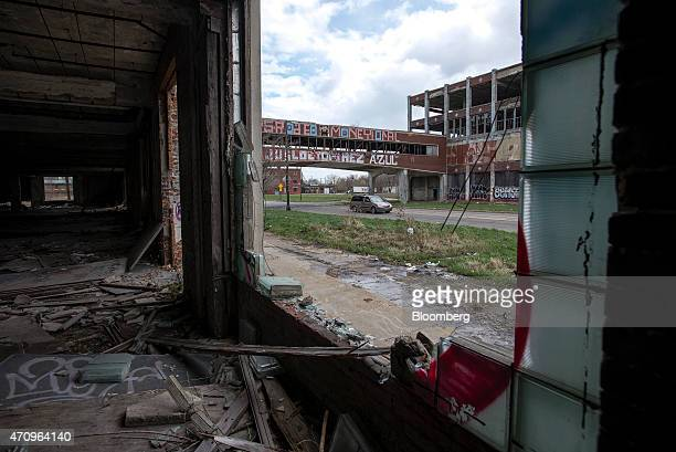 A van drives under the bridge that crosses East Grand Boulevard connecting sections of the abandoned Packard auto assembly plant in Detroit Michigan...