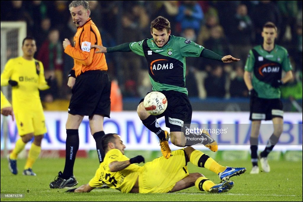 Van Eenoo Lukas of Cercle Brugge and Victor Vazquez (L) of Club Brugge KV compete for the ball during the Jupiler League match between Cercle Brugge and Club Brugge on February 28, 2013 in Brugge, Belgium.