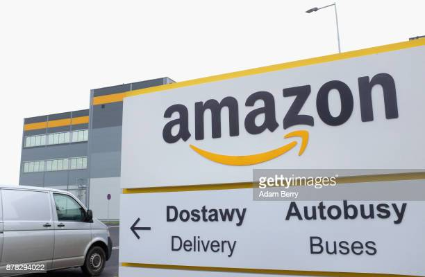 A van enters an Amazon distribution center in Kolbaskowo near Szczecin Poland on November 23 2017 Workers at Amazon the world's third largest...