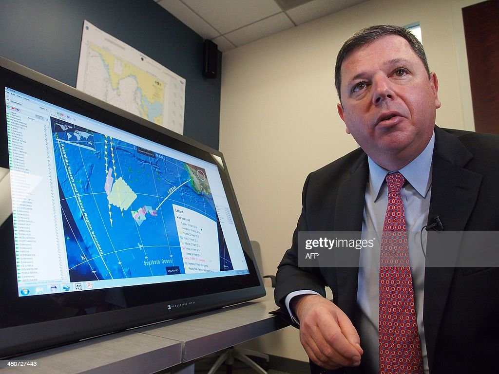 Van Gurley, senior manager with the advanced mathematics applications division of Metron, Inc., speaks at the consulting firm's head office in Reston, Virginia, on March 26, 2014 alongside a computer depiction of the search area for Malaysia Airlines Flight 370. Metron was instrumental in helping French investigators successful locate the flight data recorder from Air France flight 447 which crashed in 2009 into the Atlantic Ocean after departing Rio de Janeiro. AFP PHOTO Robert MacPherson Malaysia-China-Australia-aviation-US-technology AFP PHOTO/Robert MacPherson