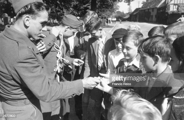 Van Horne and Tetrault two American soldiers say goodbye and 'gum chum' to Buckden village children with their last sticks of chewing gum Original...