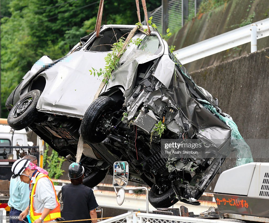 A van is salvaged a day after five people died after the car plunged into the Takihata Dam on May 30, 2016 in Kawachinagano, Osaka, Japan.