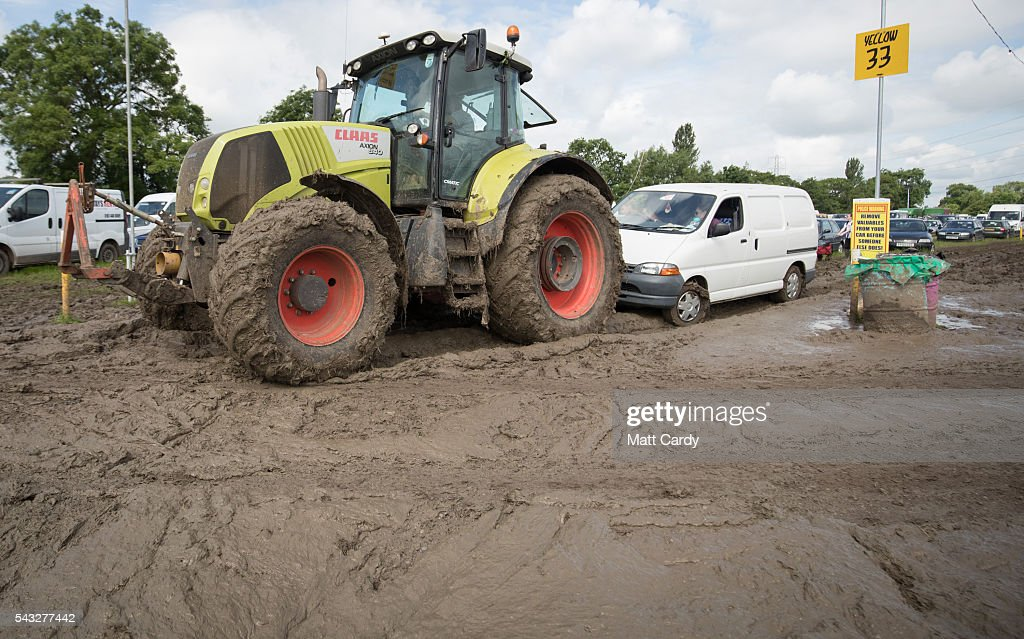 A van is towed by a tractor as festival goers leave the Glastonbury Festival 2016 at Worthy Farm, Pilton on June 26, 2016 near Glastonbury, England. The Festival, which Michael Eavis started in 1970 when several hundred hippies paid just £1, now attracts more than 175,000 people.