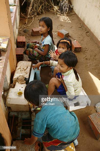 Van Kieu ethnic minority children play a cooking game at a destroyed kindergarten school in Huc Nghi commune Dakrong district Quang Tri province Most...