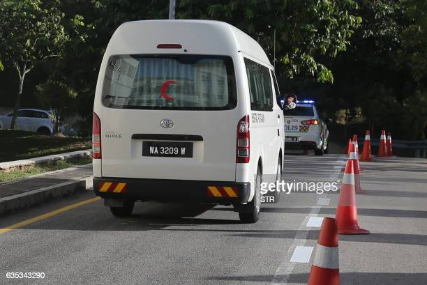 A van leaves the area outside the forensic department of Putrajaya Hospital in Putrajaya outside Kuala Lumpur on February 15 where the body of a...