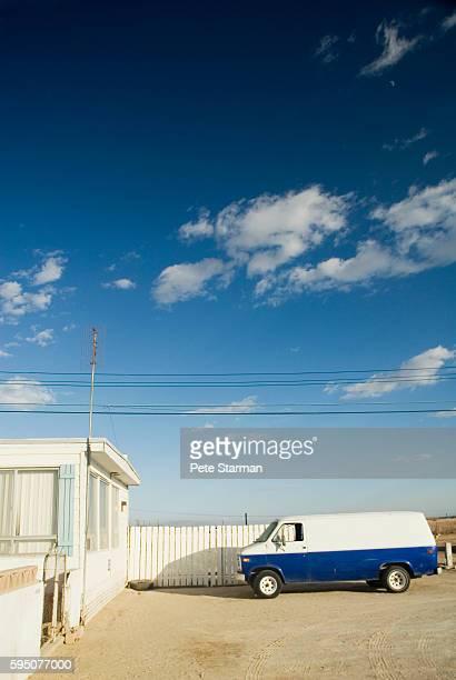 Van near mobile home