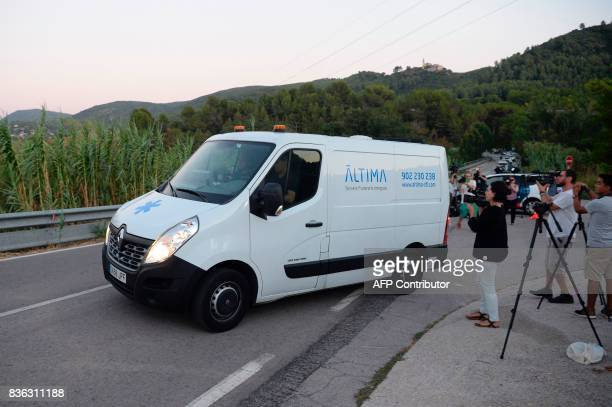 A van of the funeral services carrying the body of Moroccan suspect Younes Abouyaaqoub on the site where he was shot on August 21 2017 in Subirat...