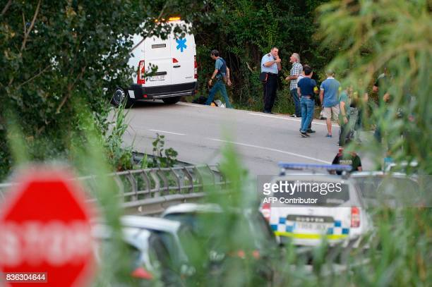 A van of the funeral services parks at the site where Moroccan suspect Younes Abouyaaqoub was shot on August 21 2017 near Sant Sadurni d'Anoia south...