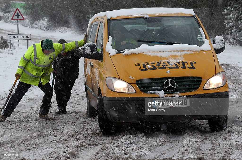 A van slips in the snow on the normally busy A367 between Bath and Peasedown St John on January 18, 2013 near Bath, England. Heavy snow is bringing widespread disruption to many parts of the UK.