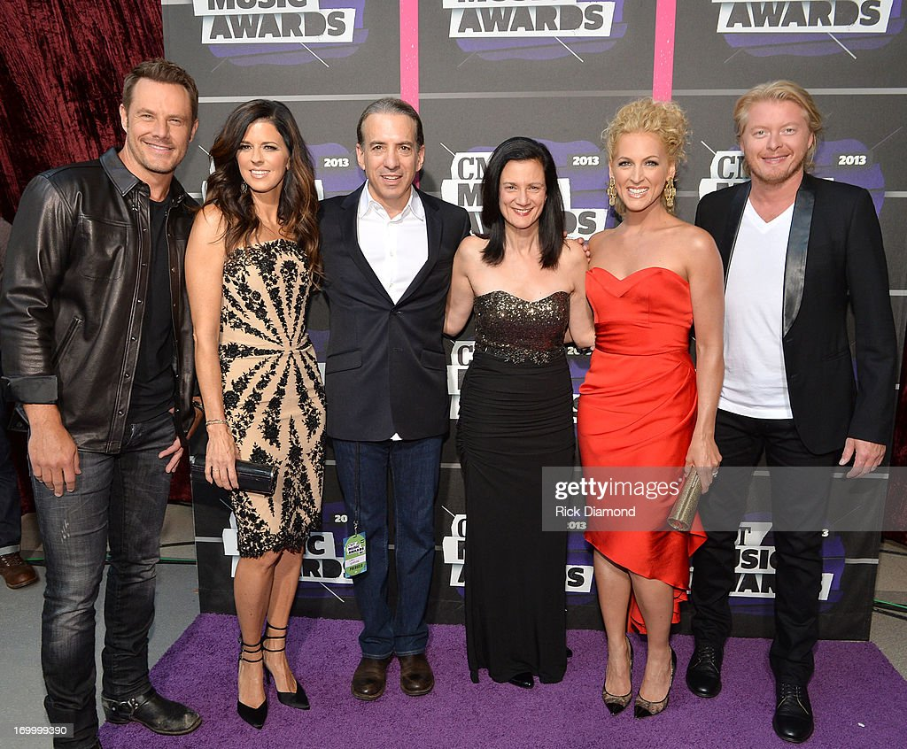 Van Toffler (third from left), President of MTV Networks Music & Logo Group at Viacom, Inc., and Leslie Fram (third from right), SVP of Music Strategy CMT, are joined by Little Big Town band members (L-R) Jimi Westbrook, Karen Fairchild, Kimberly Schlapman and Philip Sweet at the 2013 CMT Music awards at the Bridgestone Arena on June 5, 2013 in Nashville, Tennessee.