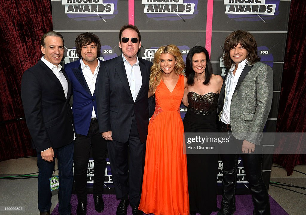 Van Toffler, President of MTV Networks Music & Logo Group at Viacom, Inc., Neil Perry, Brian Philips, President of CMT, Kimberly Perry, Leslie Fram, SVP of Music Strategy CMT, and Reid Perry of The Band Perry attend the 2013 CMT Music awards at the Bridgestone Arena on June 5, 2013 in Nashville, Tennessee.