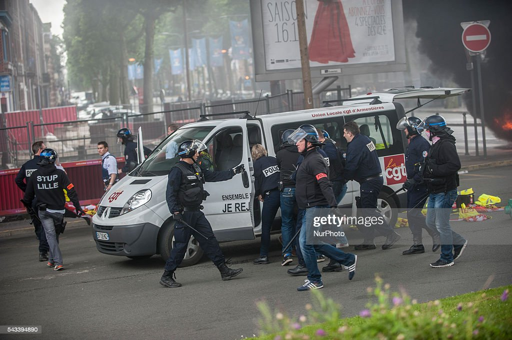 A van union CGT is stopped and the occupants arrested after the police intervention around the roundabout Post on fire in Lille, France on june 28, 2016. A new day National mobilization against the labor law takes place throughout France. Economic blocking action was planned by the CGT in Lille this morning at 6:30 am.