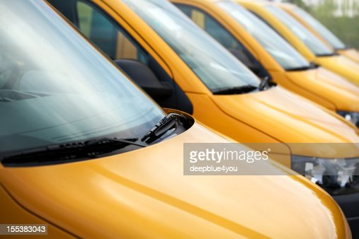 Van vehicles in a row