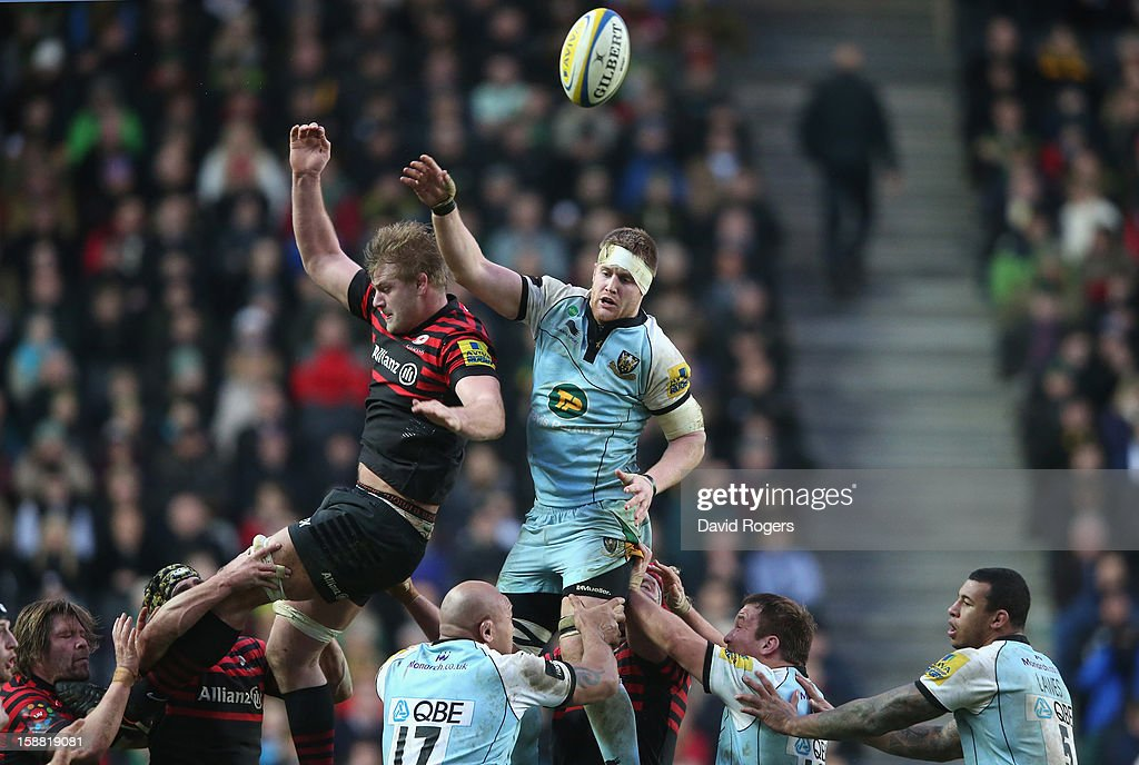 GJ van Velze of Northampton wins the ball in the lineout against George Kruis during the Aviva Premiership match between Saracens and Northampton Saints at stadiumMK on December 30, 2012 in Milton Keynes, England.