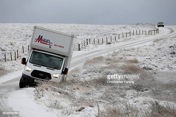 A van waits to be recovered after sliding into a ditch on an icy road in the Peak District near Buxton on January 14 2016 in Buxton England Overnight...