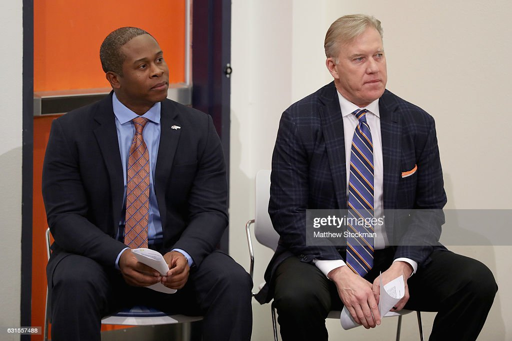 Vance Josepf waits with Denver Broncos General Manager John Elway to be introduced as the new head coach during a press conference at the Paul D. Bowlen Memorial Broncos Centre on January 12, 2017 in Englewood, Colorado.