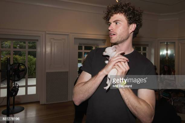 Vance Joy holds a puppy brought by Motley Zoo Animal Rescue backstage during the Summer Camp Music Festival hosted by 1077 The End at Marymoor Park...