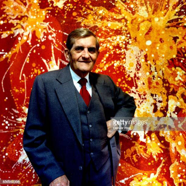 Vance Kirkland giving interest in his Denver studio April 1980 Painting in background is 1979 no 10 'the energy of explosions on the sun 30 Billion...