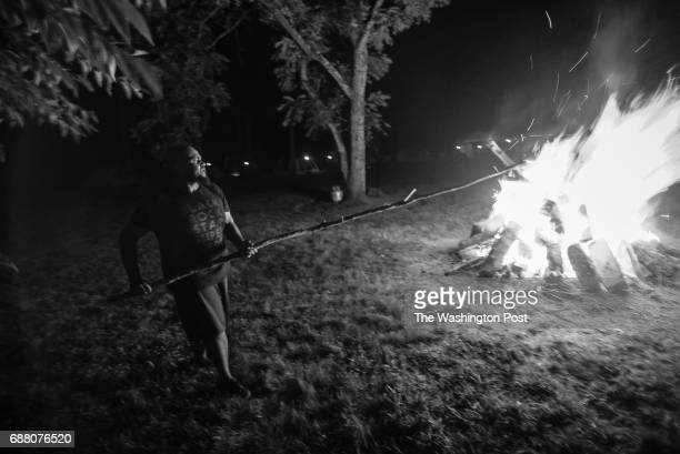 LIGNUM VA 7/23/16 Vance Levy also known as the rapper HeadRoc improvises with a 12 foot stick as he roasts marshmallows in the bonfire for smores...