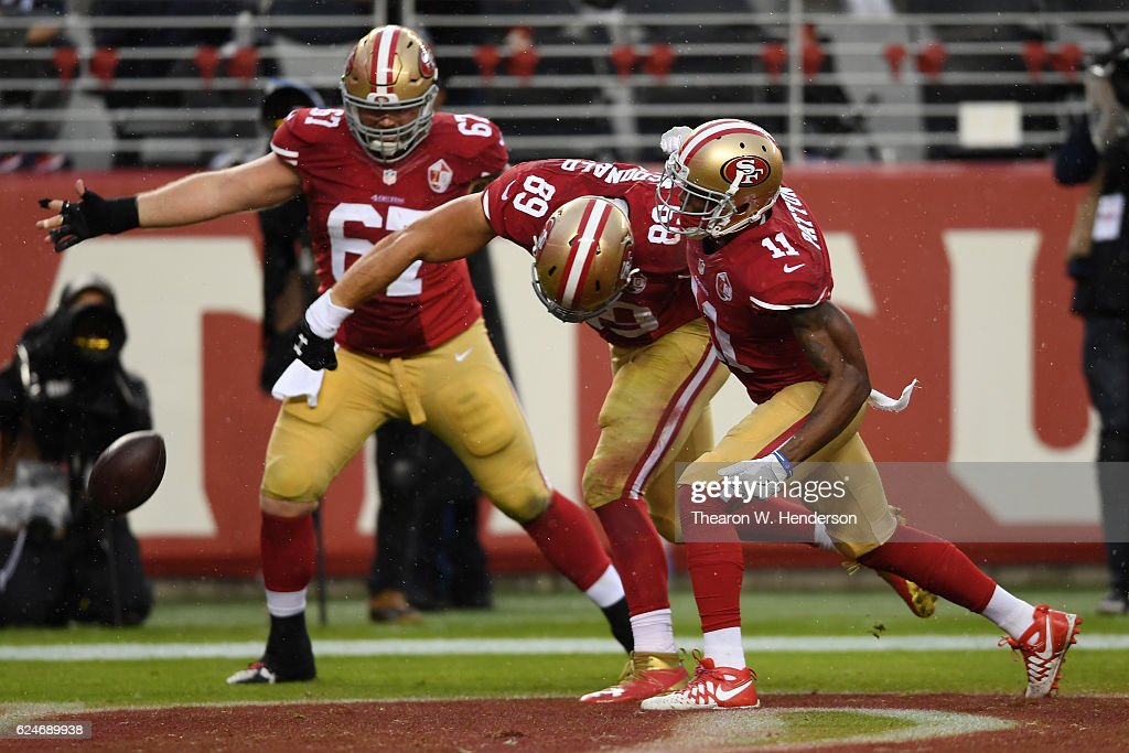 79938bc95f9 ... Vance McDonald 89 of the San Francisco 49ers celebrates after scoring  against the New England Tight end ...