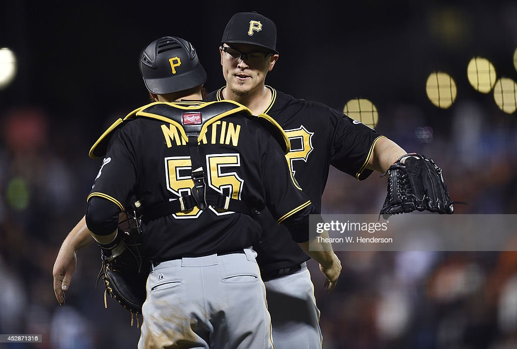Vance Worley #46 and Russell Martin #55 of the Pittsburgh Pirates celebrates defeating the San Francisco Giants 5-0 at AT&T Park on July 28, 2014 in San Francisco, California.