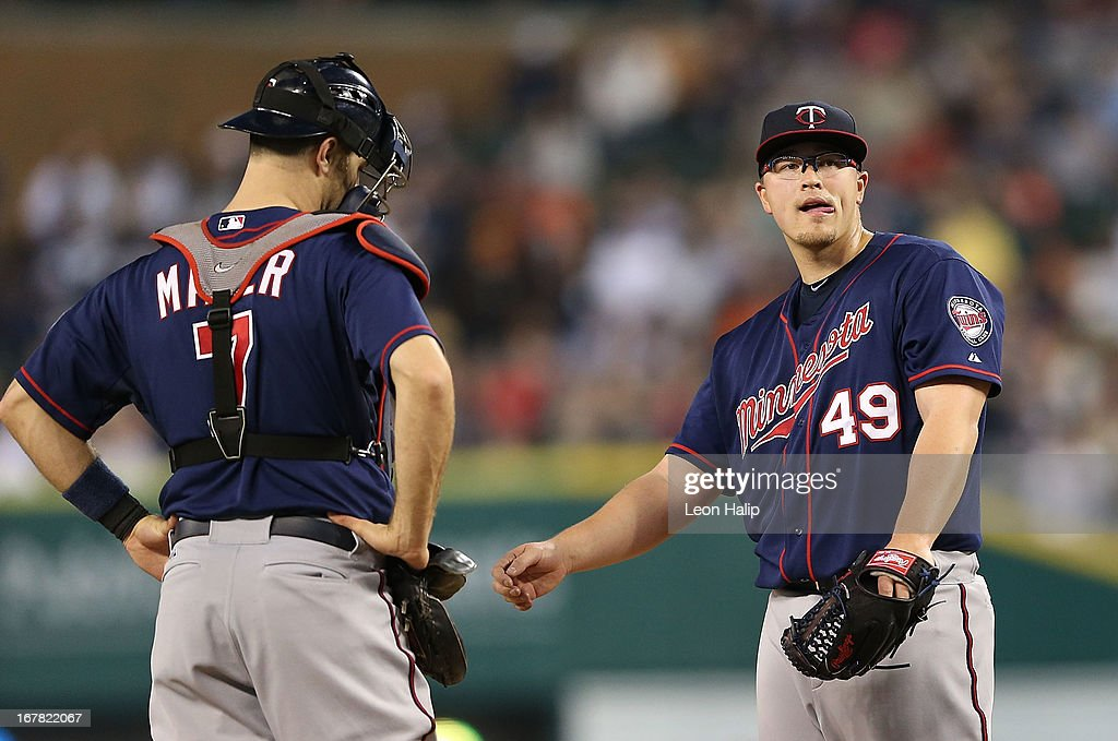 <a gi-track='captionPersonalityLinkClicked' href=/galleries/search?phrase=Vance+Worley&family=editorial&specificpeople=7115988 ng-click='$event.stopPropagation()'>Vance Worley</a> #49 of the Minnesota Twins reacts after giving up a home run to <a gi-track='captionPersonalityLinkClicked' href=/galleries/search?phrase=Prince+Fielder&family=editorial&specificpeople=209392 ng-click='$event.stopPropagation()'>Prince Fielder</a> #28 of the Detroit Tigers in the fifth inning of the game at Comerica Park on April 30, 2013 in Detroit, Michigan. The Tigers defeated the Twins 6-1.