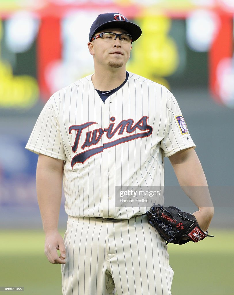 <a gi-track='captionPersonalityLinkClicked' href=/galleries/search?phrase=Vance+Worley&family=editorial&specificpeople=7115988 ng-click='$event.stopPropagation()'>Vance Worley</a> #49 of the Minnesota Twins reacts after giving up a home run to Matt Wieters #32 of the Baltimore Orioles during the fourth inning of the game on May 11, 2013 at Target Field in Minneapolis, Minnesota.