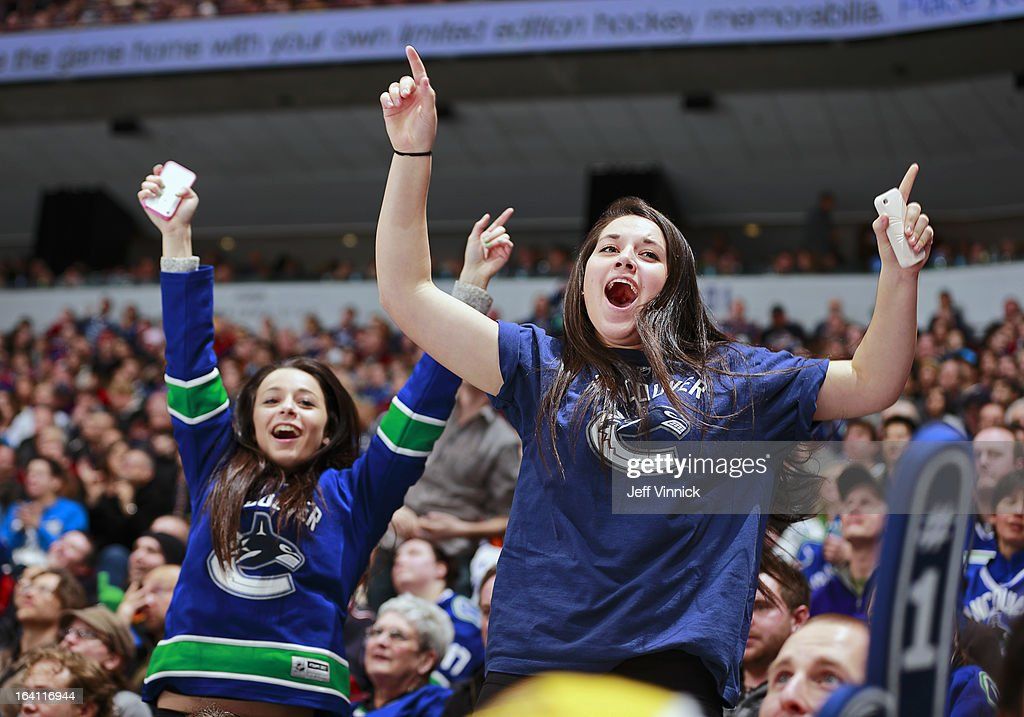 Vancouver Canuck fans cheer during their NHL game between the St. Louis Blues and the Vancouver Canucks at Rogers Arena March 19, 2013 in Vancouver, British Columbia, Canada. Vancouver won 3-2.