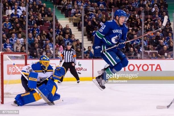 Vancouver Canucks Center Bo Horvat jumps as St Louis Blues Goalie Jake Allen tracks the puck during their NHL game at Rogers Arena on November 18...