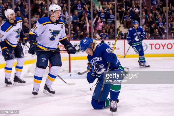 Vancouver Canucks Center Markus Granlund celebrates after scoring a goal as St Louis Blues Right Wing Vladimir Tarasenko looks on during their NHL...