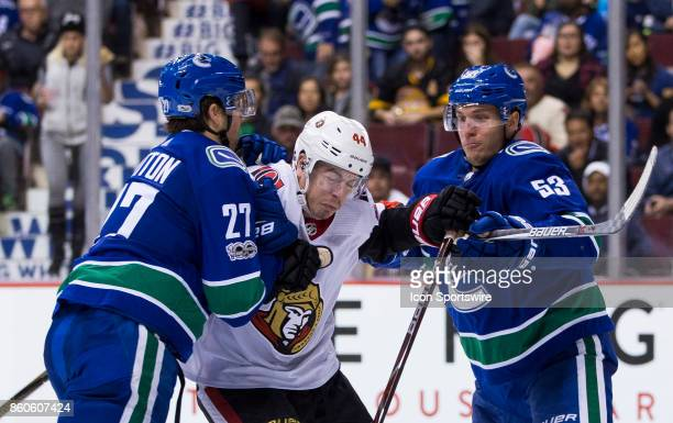 Vancouver Canucks Defenceman Ben Hutton and Center Bo Horvat check Ottawa Senators Center JeanGabriel Pageau during a NHL hockey game on October 10...