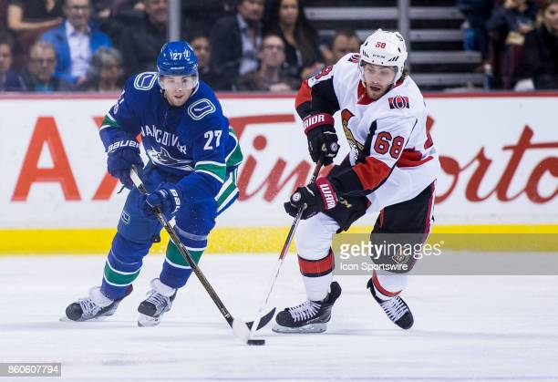 Vancouver Canucks Defenceman Ben Hutton attempts to check Ottawa Senators Left Wing Mike Hoffman during a NHL hockey game on October 10 at Rogers...